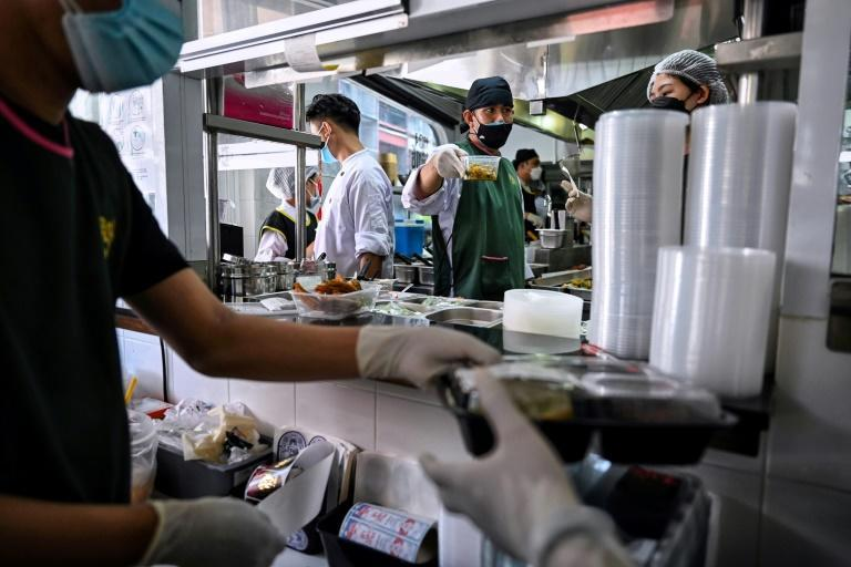 One recent study in Bangkok found plastic waste has nearly doubled during the pandemic, some of it because of food delivery services (AFP/Lillian SUWANRUMPHA)
