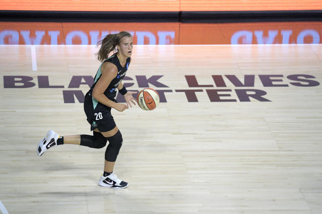 New York Liberty forward Sabrina Ionescu (20) pushes the ball up the court during the first half of a WNBA basketball game against the Seattle Storm, Saturday, July 25, 2020, in Ellenton, Fla. (AP Photo/Phelan M. Ebenhack)
