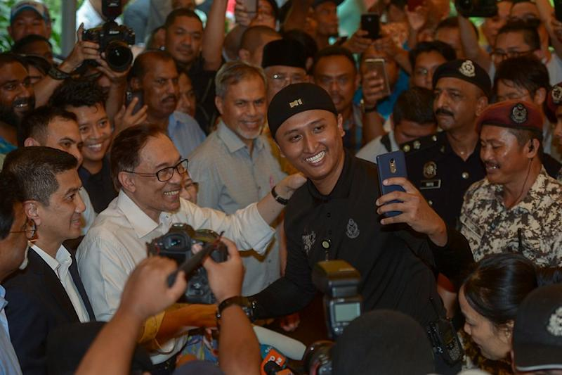 Police raid properties of ousted leader of Malaysia