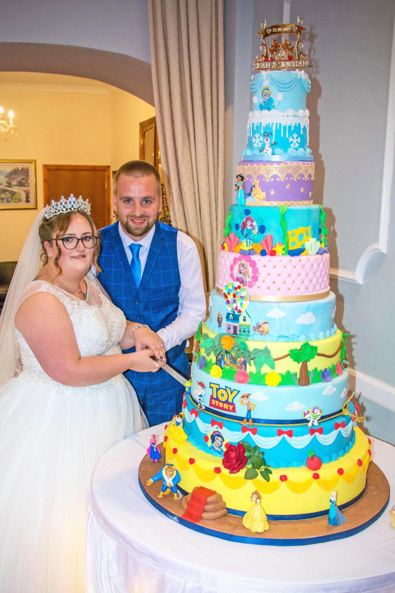 Disney superfans Siobhan Perdue, 24, and Sean, 29, tied the knot on October 12. [Photo: Caters]