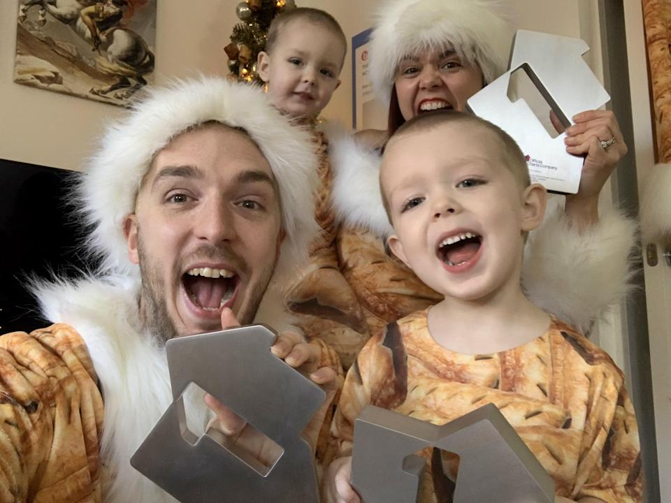 Mark and Roxanne Hoyle with their children, Kobe and Phoenix, celebrating a third Christmas number one