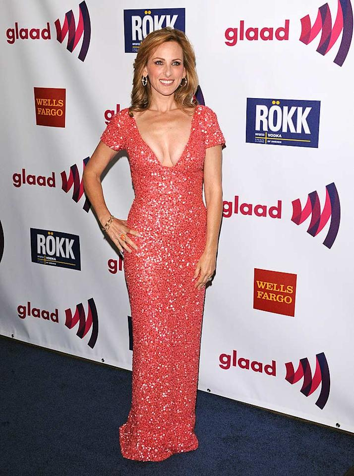 """Oscar winner and current """"Celebrity Apprentice"""" contestant Marlee Matlin popped a pose upon arriving at the 22nd annual GLAAD Media Awards in a curve-hugging, coral-colored dress and her signature smile. Jean Baptiste Lacroix/<a href=""""http://www.wireimage.com"""" target=""""new"""">WireImage.com</a> - April 10, 2011"""