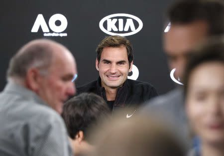 Tennis - Australian Open - Melbourne, Australia, January 14, 2018. Roger Federer of Switzerland smiles during a news conference before the Australian Open tennis tournament. REUTERS/Edgar Su
