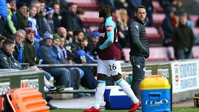 The FA have issued a stern punishment to the Hammers defender after he spat at Wigan Athletic's Nick Powell during an FA Cup fourth round clash