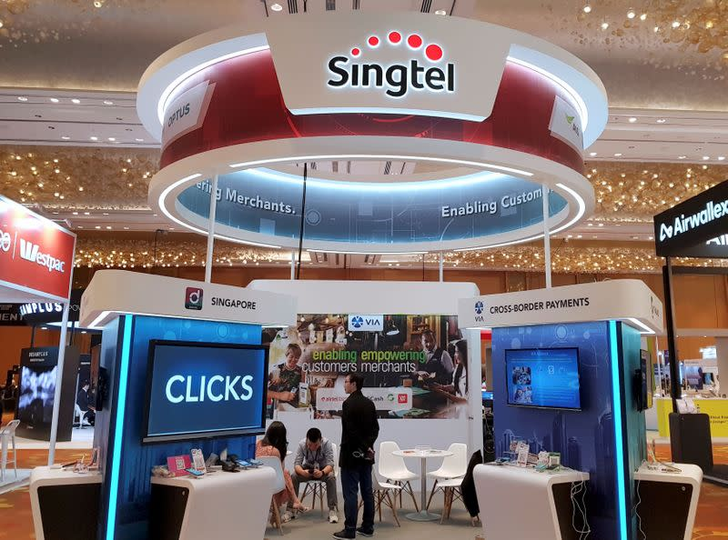 FILE PHOTO: A Singtel booth is pictured at the Money 20/20 Asia Fintech Trade Show in Singapore