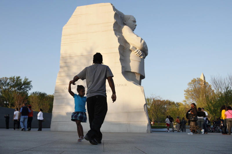 FILE - In this April 4, 2012 file photo, people visit the Martin Luther King, Jr. Memorial in Washington. Whether visitors want to try one of the first family's favorite restaurants, discover a sense of history or escape from the crowd to find a museum off the beaten path, Washington is the nation's cultural capital this weekend for inauguration visitors. (AP Photo/Jacquelyn Martin, File)