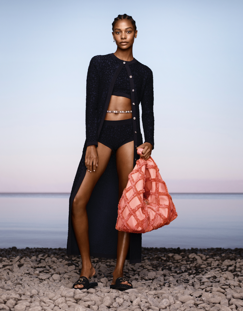 """<p>Chanel's resort 2021 collection would have brought guests to Capri, but because of the COVID-19 global pandemic, Creative Director Virginie Viard reworked her plans. She said in a statement, """"We had to adapt: not only did we decide to use fabrics that we already had, but the collection, more generally, evolved towards a trip around the Mediterranean…"""" The pieces in this collection are designed with the traveler in mind as many are multifunctional: long skirts turn into strapless dresses when pulled up and jackets in black chiffon can be worn by day over a bikini. </p>"""
