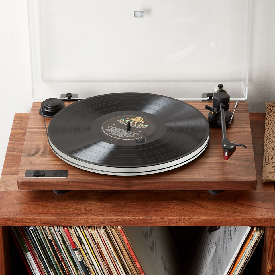 "<br><br><strong>Ortofon</strong> Orbit Special Walnut Turntable with Built-In Pre Amp, $, available at <a href=""https://go.skimresources.com/?id=30283X879131&url=https%3A%2F%2Fwww.cb2.com%2Forbit-special-walnut-turntable-with-built-in-pre-amp%2Fs433134"" rel=""nofollow noopener"" target=""_blank"" data-ylk=""slk:CB2"" class=""link rapid-noclick-resp"">CB2</a>"