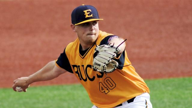 """East Tennessee State's Landon Knack pitches against Wofford on April 19, 2019, in Johnson City, Tenn. <span class=""""copyright"""">(Shawn Millsaps / Associated Press)</span>"""