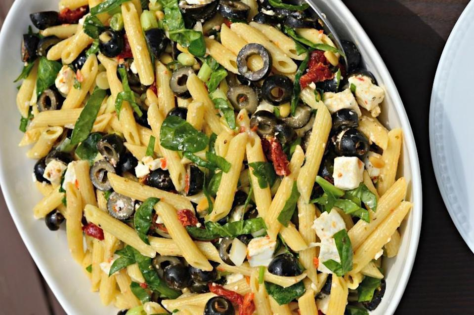 """<p>This Greek penne pasta dish with black olives, sun-dried tomatoes, pine nuts and feta cheese has something to discover in every bite. Be sure to <a href=""""https://www.thedailymeal.com/cook/how-much-pasta-water?referrer=yahoo&category=beauty_food&include_utm=1&utm_medium=referral&utm_source=yahoo&utm_campaign=feed"""" rel=""""nofollow noopener"""" target=""""_blank"""" data-ylk=""""slk:reserve a bit of pasta water"""" class=""""link rapid-noclick-resp"""">reserve a bit of pasta water</a> and add it to your sauce.</p> <p><a href=""""https://www.thedailymeal.com/recipes/penne-black-olives-sun-dried-tomatoes-feta-and-spinach-recipe?referrer=yahoo&category=beauty_food&include_utm=1&utm_medium=referral&utm_source=yahoo&utm_campaign=feed"""" rel=""""nofollow noopener"""" target=""""_blank"""" data-ylk=""""slk:For the Greek-inspired Penne recipe, click here."""" class=""""link rapid-noclick-resp"""">For the Greek-inspired Penne recipe, click here.</a></p>"""