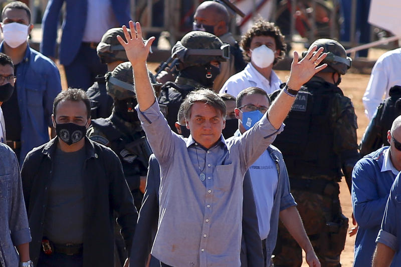 Brazilian President Jair Bolsonaro (C) waves to supporters during the inauguration of a field hospital in Aguas Lindas, in the State of Goiais, Brazil, on 05 June 2020, amid the Covid-19 coronavirus pandemic. (Photo by Sergio LIMA / AFP) (Photo by SERGIO LIMA/AFP via Getty Images)