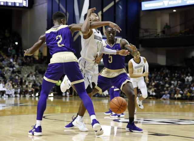 Vanderbilt guard Darius Garland (10) loses the ball as he drives between Alcorn State defenders Jael Scott (2) and Khari Jabriel Allen (5) in the first half of an NCAA college basketball game Friday, Nov. 16, 2018, in Nashville, Tenn. (AP Photo/Mark Humphrey)