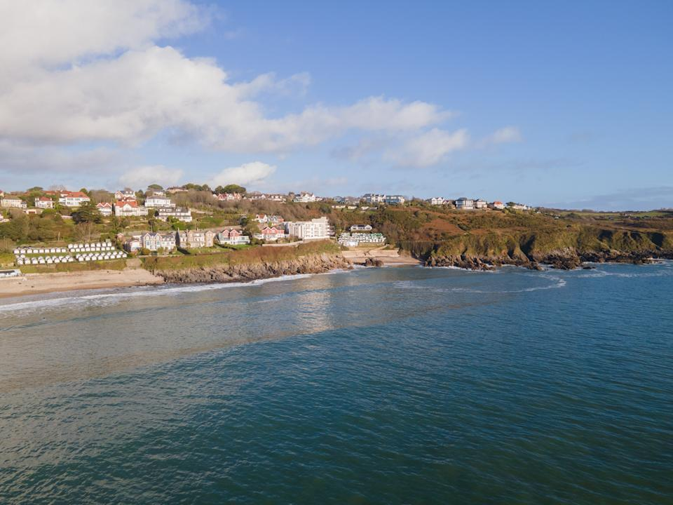 Looking Into Langland Bay in Gower, Wales, UK from the sea on a clean late Autumn day. Blue skies with some clouds