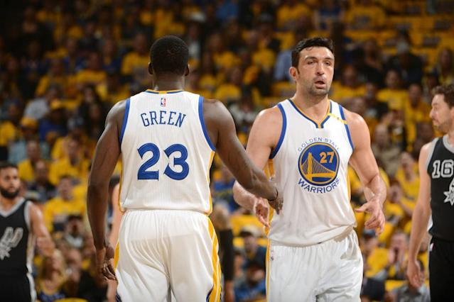 "<a class=""link rapid-noclick-resp"" href=""/nba/players/3745/"" data-ylk=""slk:Zaza Pachulia"">Zaza Pachulia</a> high-fives <a class=""link rapid-noclick-resp"" href=""/nba/players/5069/"" data-ylk=""slk:Draymond Green"">Draymond Green</a> during the first quarter of Game 2 against the <a class=""link rapid-noclick-resp"" href=""/nba/teams/sas/"" data-ylk=""slk:San Antonio Spurs"">San Antonio Spurs</a>. (Noah Graham/NBAE/Getty Images)"