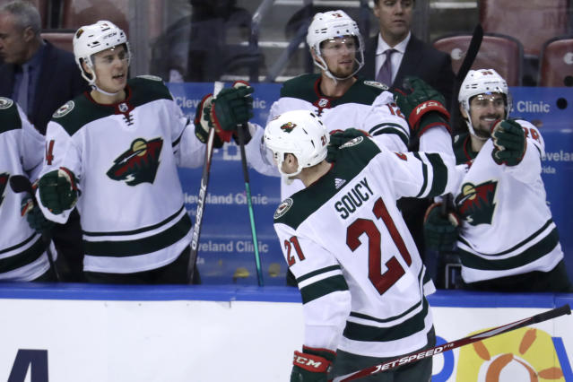 Minnesota Wild defenseman Carson Soucy (21) is congratulated after scoring a goal during the third period of an NHL hockey game against the Florida Panthers, Tuesday, Dec. 3, 2019, in Sunrise, Fla. The Wild won 4-2. (AP Photo/Lynne Sladky)