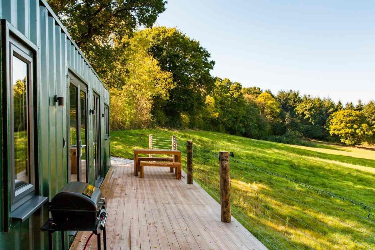 "<p>Providing you with the peace and tranquillity that the county is loved for, this Airbnb in Devon is an utter treat. A converted shipping container in the village of Poltimore, just a few miles from Exeter, this <a href=""https://www.goodhousekeeping.com/uk/lifestyle/travel/a32876671/airbnb-most-wished-for-holiday-rentals/"" target=""_blank"">quirky holiday rental</a> is set in an attractive meadow with views of rolling countryside.</p><p>Inside, the Airbnb is stylish and cosy, with bespoke pine-topped stools, handmade reading chairs and board games. The kitchen is pretty fancy too.</p><p><strong>Sleeps</strong>: 4</p><p><strong>Price per night:</strong> £90</p><p><strong>Why we love it:</strong> The quirky Airbnb is super snug. After a long country walk, you can fire up the log burner, pour a glass of wine and relax in the cosy living space.</p><p><a class=""body-btn-link"" href=""https://go.redirectingat.com?id=127X1599956&url=https%3A%2F%2Fwww.airbnb.co.uk%2Frooms%2Fplus%2F26621985%2F&sref=https%3A%2F%2Fwww.countryliving.com%2Fuk%2Ftravel-ideas%2Fstaycation-uk%2Fg32930188%2Fairbnb-cornwall-devon%2F"" target=""_blank"">SEE INSIDE</a></p>"