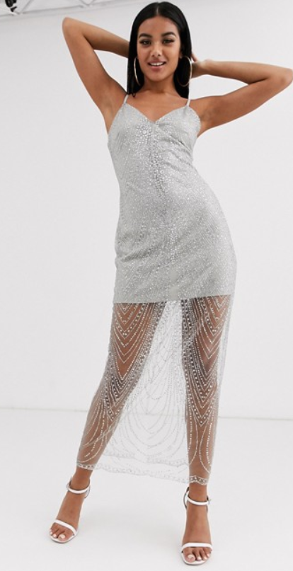 The Missguided glitter mesh midaxi dress in silver, $67.50 (RRP $90) from ASOS. Photo: ASOS.
