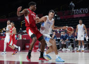 Argentina's Luis Scola (4) drives around Japan's Rui Hachimura (8) during men's basketball preliminary round game at the 2020 Summer Olympics, Sunday, Aug. 1, 2021, in Saitama, Japan. (AP Photo/Charlie Neibergall)