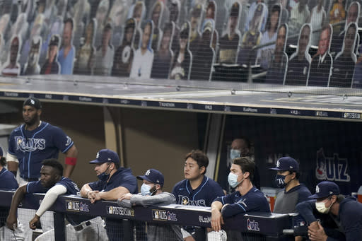 The Tampa Bay Rays watch play from the dugout during the eighth inning against the New York Yankees in Game one of a baseball American League Division Series Monday, Oct. 5, 2020, in San Diego. (AP Photo/Jae C. Hong)