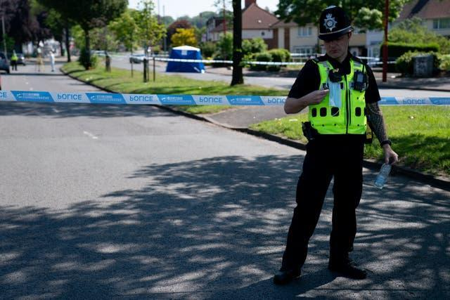 A police officer stands near the scene