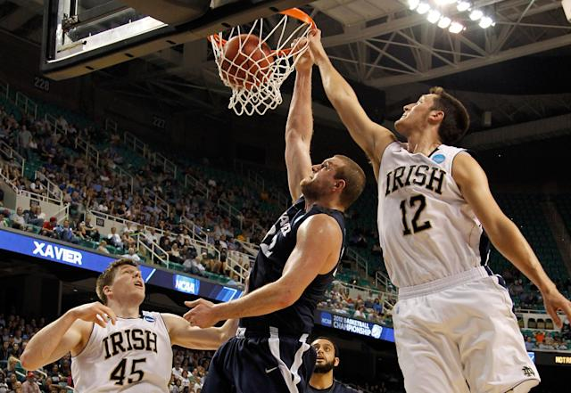 GREENSBORO, NC - MARCH 16: Kenny Frease #32 of the Xavier Musketeers dunks on Alex Dragicevich #12 of the Notre Dame Fighting Irish in the first half during the second round of the 2012 NCAA Men's Basketball Tournament at Greensboro Coliseum on March 16, 2012 in Greensboro, North Carolina. (Photo by Mike Ehrmann/Getty Images)