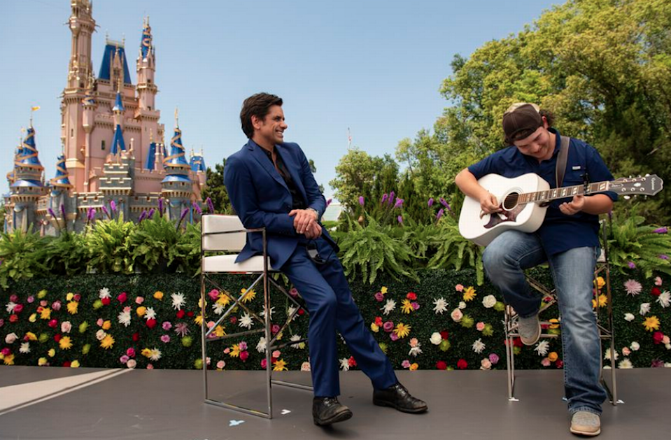 John Stamos, left, gave American Idol contestant Caleb Kennedy some advice at stage presence.
