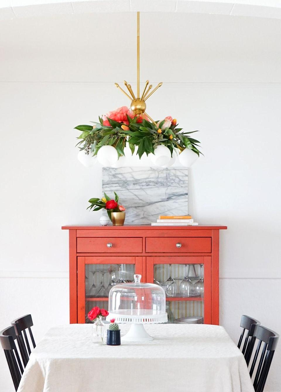 """<p>Make this sophisticated garland even more holiday-appropriate by using red or white poinsettias. </p><p><a href=""""https://sugarandcloth.com/diy-floral-chandelier/"""" rel=""""nofollow noopener"""" target=""""_blank"""" data-ylk=""""slk:Get the tutorial."""" class=""""link rapid-noclick-resp"""">Get the tutorial.</a></p><p><a class=""""link rapid-noclick-resp"""" href=""""https://www.amazon.com/dp/B07W6TWD6V?tag=syn-yahoo-20&ascsubtag=%5Bartid%7C10072.g.37499128%5Bsrc%7Cyahoo-us"""" rel=""""nofollow noopener"""" target=""""_blank"""" data-ylk=""""slk:SHOP FLORAL WIRE"""">SHOP FLORAL WIRE</a></p>"""