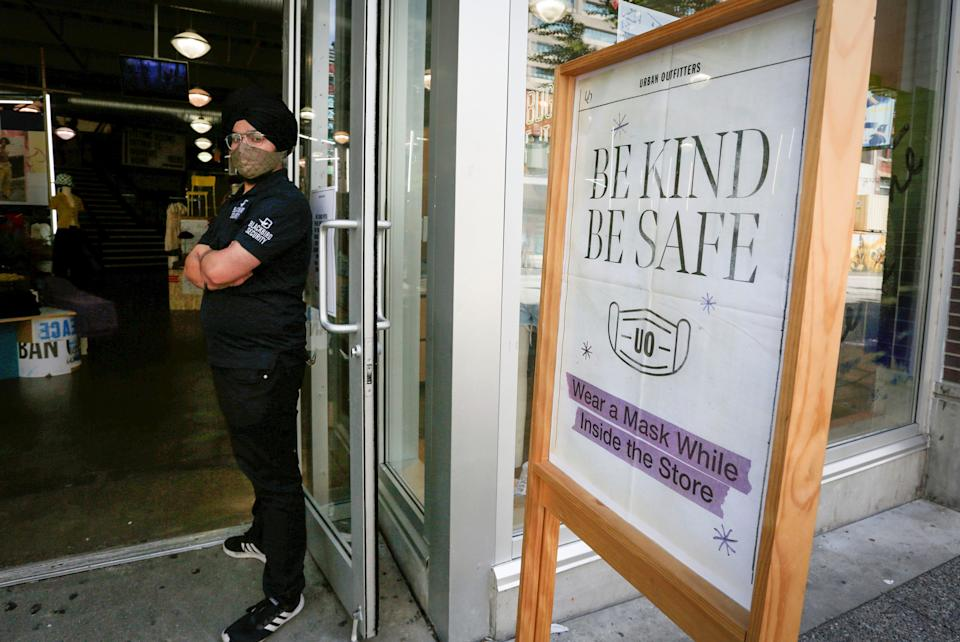A sign is seen outside a store to remind customers to wear masks in Vancouver, British Columbia, Canada, on Aug. 25, 2021. British Columbia's public health order requiring masks in most indoor public settings came into effect Wednesday, in an effort to combat the Delta variant and a fourth wave of COVID-19. (Photo by Liang Sen/Xinhua via Getty Images)