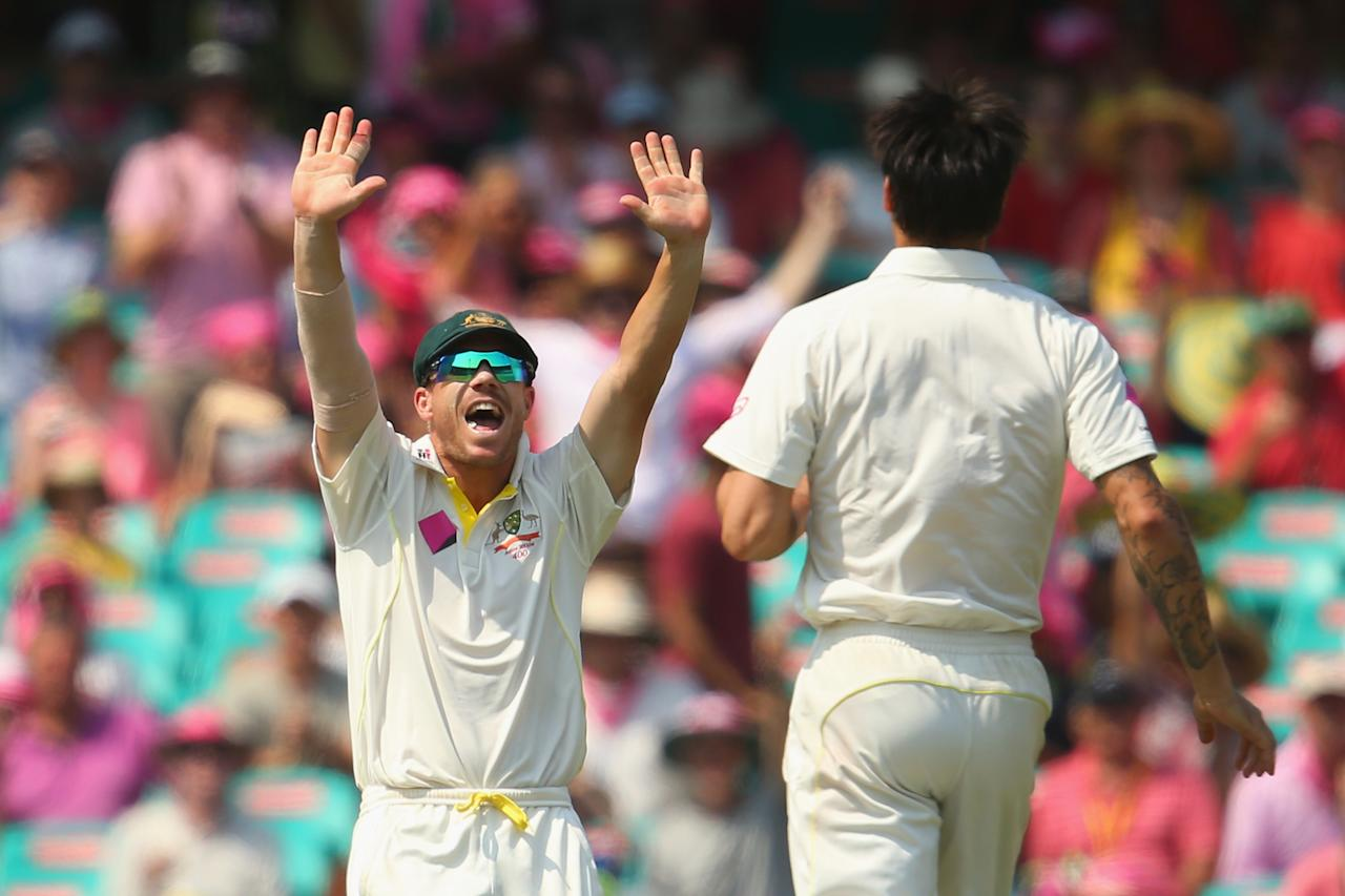 SYDNEY, AUSTRALIA - JANUARY 05:  David Warner of Australia celebrates with Mitchell Johnson of Australia after he took the wicket of Michael Carberry of England during day three of the Fifth Ashes Test match between Australia and England at Sydney Cricket Ground on January 5, 2014 in Sydney, Australia.  (Photo by Mark Kolbe/Getty Images)