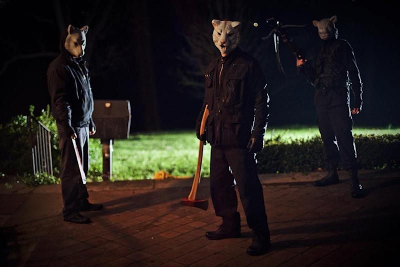 """This film publicity image released by Lionsgate shows a scene from """"You're Next."""" (AP Photo/Lionsgate, Corey Ransberg)"""