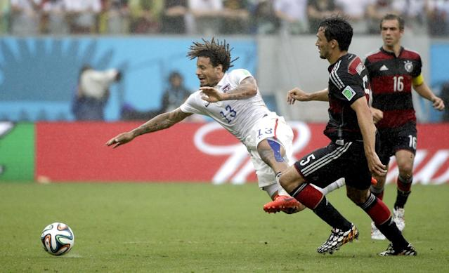 United States' Jermaine Jones is tripped by Germany's Mats Hummels during the group G World Cup soccer match between the USA and Germany at the Arena Pernambuco in Recife, Brazil, Thursday, June 26, 2014. (AP Photo/Ricardo Mazalan)