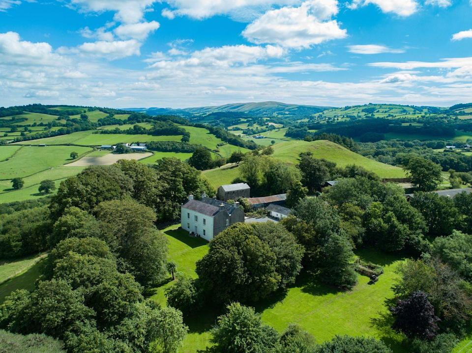 """<p>Surrounded by idyllic countryside, this breathtaking home is situated on the edge of the Brecon Beacons National Park — just three miles from Prince Charles' Welsh home, Llwynywermod. </p><p><a href=""""https://www.knightfrank.co.uk/properties/residential/for-sale/llangadog-carmarthenshire-sa19/cho012087863"""" rel=""""nofollow noopener"""" target=""""_blank"""" data-ylk=""""slk:This property is currently for sale for £2,750,000 via Knight Frank"""" class=""""link rapid-noclick-resp"""">This property is currently for sale for £2,750,000 via Knight Frank</a>. </p>"""