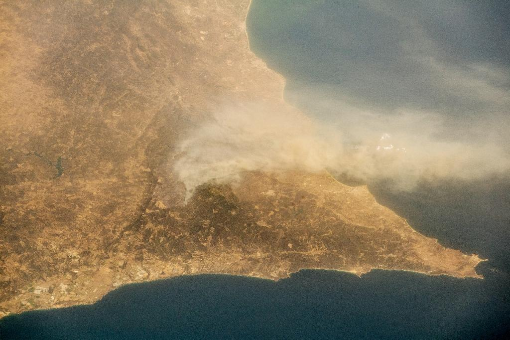 <p>Images released by the European Space Agency appear to show that the fire — which began on Friday in the eucalyptus and pine forests in the hills on Monchique — is visible from the International Space Station (Photo: Alexander Gerst/AFP) </p>