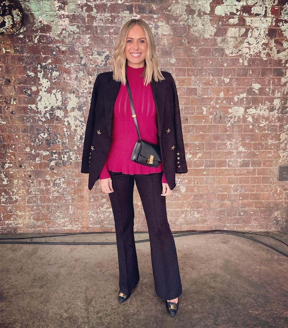 Sylvia Jeffries wearing a black blazer by Rebecca Vallance and a pink top at Australian Fashion Week