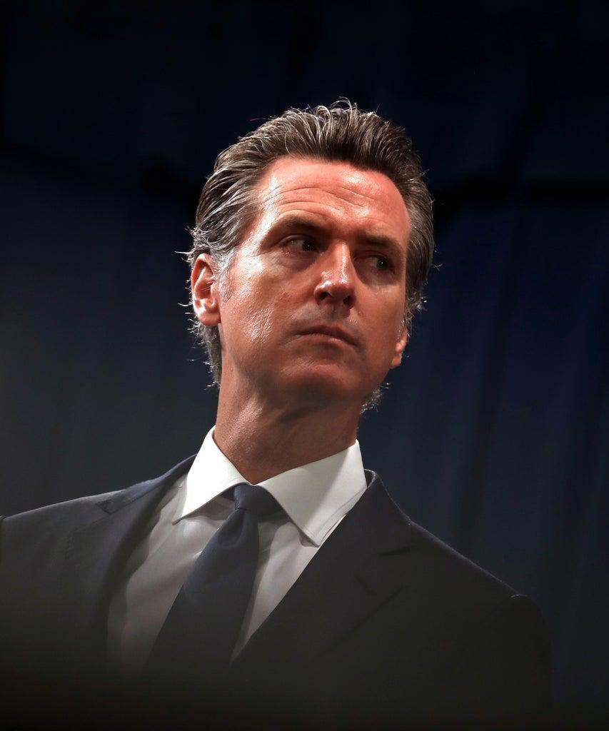 """SACRAMENTO, CALIFORNIA – AUGUST 16: California Gov. Gavin Newsom looks on during a news conference with California attorney General Xavier Becerra at the California State Capitol on August 16, 2019 in Sacramento, California. California attorney genera Xavier Becerra and California Gov. Gavin Newsom announced that the State of California is suing the Trump administration challenging the legality of a new """"public charge"""" rule that would make it difficult for immigrants to obtain green cards who receive public assistance like food stamps and Medicaid. (Photo by Justin Sullivan/Getty Images)"""
