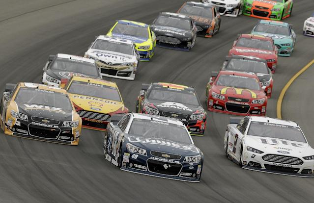 Jimmie Johnson (48) races during the NASCAR Sprint Cup Series Pure Michigan 400 auto race at Michigan International Speedway in Brooklyn, Mich., Sunday, Aug. 17, 2014. (AP Photo/Paul Sancya)