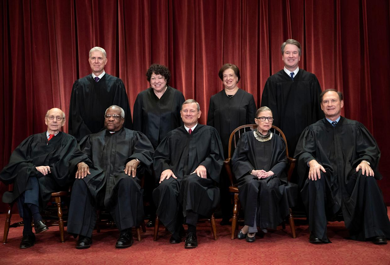 The justices of the U.S. Supreme Court. Seated from left: Associate Justice Stephen Breyer, Associate Justice Clarence Thomas, Chief Justice John Roberts, Associate Justice Ruth Bader Ginsburg and Associate Justice Samuel Alito Jr. Standing from left: Associate Justice Neil Gorsuch, Associate Justice Sonia Sotomayor, Associate Justice Elena Kagan and Associate Justice Brett Kavanaugh. (Photo: J. Scott Applewhite/AP)