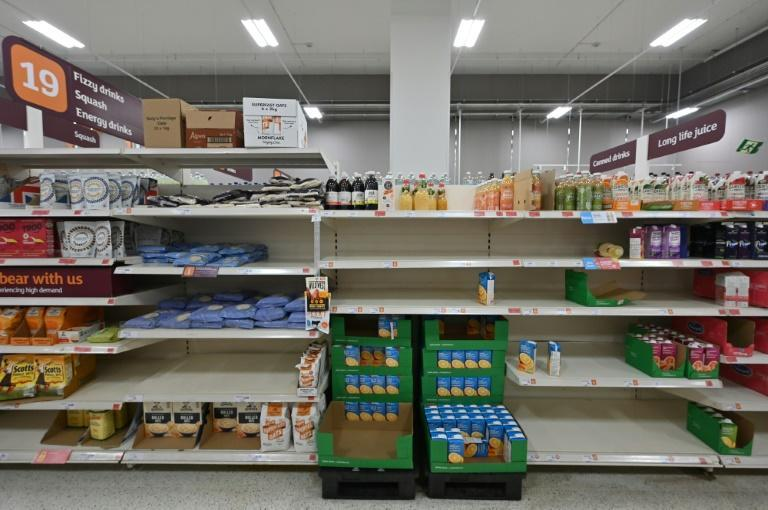 Empty shelves in a Sainsbury's supermarket in London (AFP/JUSTIN TALLIS)
