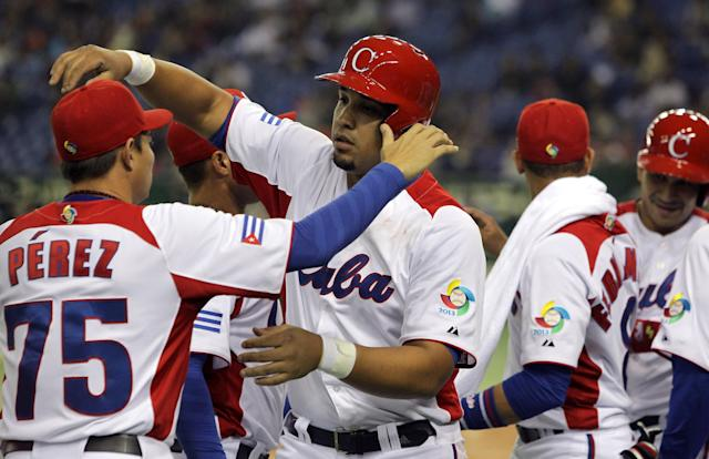 TOKYO, JAPAN - MARCH 09: Jose Abreu # 79 celebrates with Wilber Perez # 75 of Cuba after two run home run in the sixth inning during the World Baseball Classic Second Round Pool 1 game between Chinese Taipei and Cuba at Tokyo Dome on March 9, 2013 in Tokyo, Japan. (Photo by Chung Sung-Jun/Getty Images)