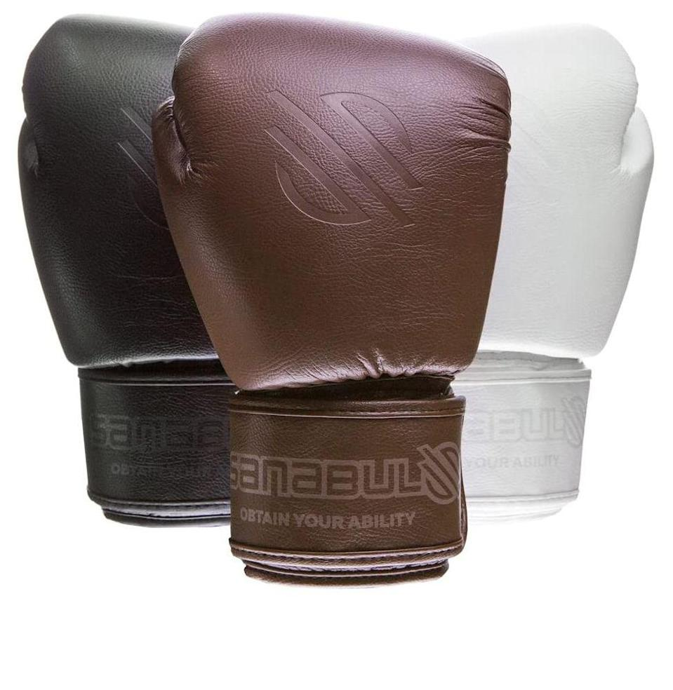 "<p><strong><em>Sanabul Striking Gloves</em></strong><br><em>$50, <a href=""https://sanabulsports.com/collections/striking-equipment/products/muay-thai-gloves-battle-forged"" rel=""nofollow noopener"" target=""_blank"" data-ylk=""slk:sanabulsport.com"" class=""link rapid-noclick-resp"">sanabulsport.com</a></em><br><a class=""link rapid-noclick-resp"" href=""https://sanabulsports.com/collections/striking-equipment/products/muay-thai-gloves-battle-forged"" rel=""nofollow noopener"" target=""_blank"" data-ylk=""slk:Buy"">Buy</a></p><p>Workout fashion is a whole new world. With my newfound boxing love, I wanted some cool gloves that were also comfortable. Sanabul has a ton of striking equipment, from MMA gloves to boxing gloves, and they're all gorgeous (and all animal-free). The designs include bright translucents and retro stylings, and even some <em>Star Wars</em> collaborations. My personal favorite is the brown battle-forged glove that you see here, because it made me feel like I was stepping out of <em>Rocky</em>. Listen, even if you don't box, there are few things as fun as running around your apartment acting like an '80s boxing star.<br></p>"