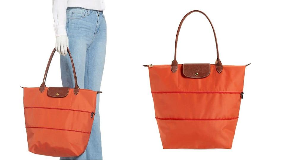 The zipper allows you to customize the size of this Longchamp tote.