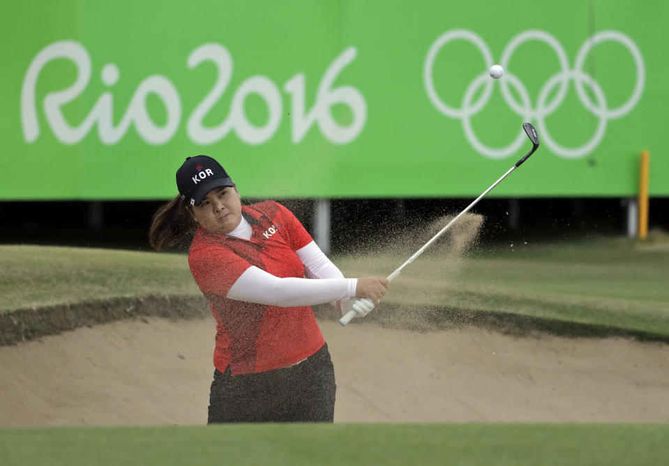 FILE - In this Aug. 20, 2016, file photo, Inbee Park of South Korea, hits from a bunker on the 18th hole during the final round of the women's golf event at the Summer Olympics in Rio de Janeiro. Park won the gold medal. All three medalists from Rio, starting with seven-time major champion and gold medalist Park, are back.(AP Photo/Chris Carlson, File)