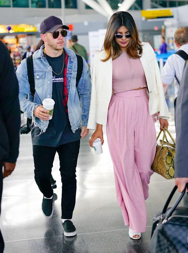 <p>Priyanka Chopra and Nick Jonas at JFK in June. (Photo: Gotham/GC Images) </p>