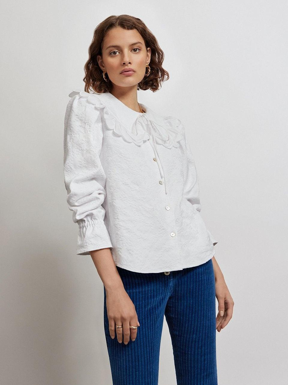 """<br><br><strong>Kitri x Jessie Bush</strong> Charlotte White Jacquard Top, $, available at <a href=""""https://kitristudio.com/products/charlotte-white-jacquard-top"""" rel=""""nofollow noopener"""" target=""""_blank"""" data-ylk=""""slk:Kitri"""" class=""""link rapid-noclick-resp"""">Kitri</a>"""