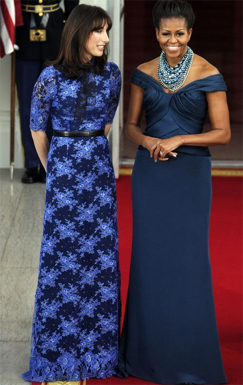 <b>Dinner at the White House, March 2012</b><br><br>At a dinner thrown by the Obamas, Michelle matched Samantha Cameron with in floorlength blue. Michelle's teal off-the-shoulder Marchesa gown was designed by Georgina Chapman, set off with a Tom Binns necklace.