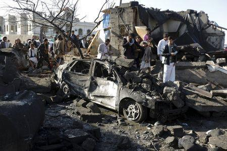 People gather at the site of an air strike at a residential area near Sanaa Airport March 26, 2015. REUTERS/Khaled Abdullah