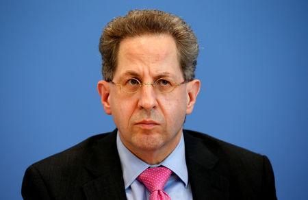 FILE PHOTO: Hans-Georg Maassen, Germany's head of the German Federal Office for the Protection of the Constitution (Bundesamt fuer Verfassungsschutz) addresses a news conference to introduce the agency's 2015 report on threats to the constitution in Berlin, Germany, June 28, 2016. REUTERS/Fabrizio Bensch/File Photo