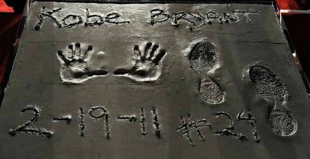The handprints and footprints made by the late NBA star Kobe Bryant in 2011 at Grauman' Chinese Theater in Hollywood are among items set to be auctioned next month (AFP Photo/GABRIEL BOUYS)