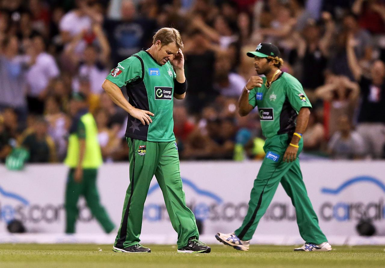 MELBOURNE, AUSTRALIA - DECEMBER 07:  Shane Warne of The Stars reacts after dropping a catch hit by Faf Du Plessis of The Renegades during the Big Bash League match between the Melbourne Renegades and the Melbourne Stars at Etihad Stadium on December 7, 2012 in Melbourne, Australia.  (Photo by Michael Dodge/Getty Images)