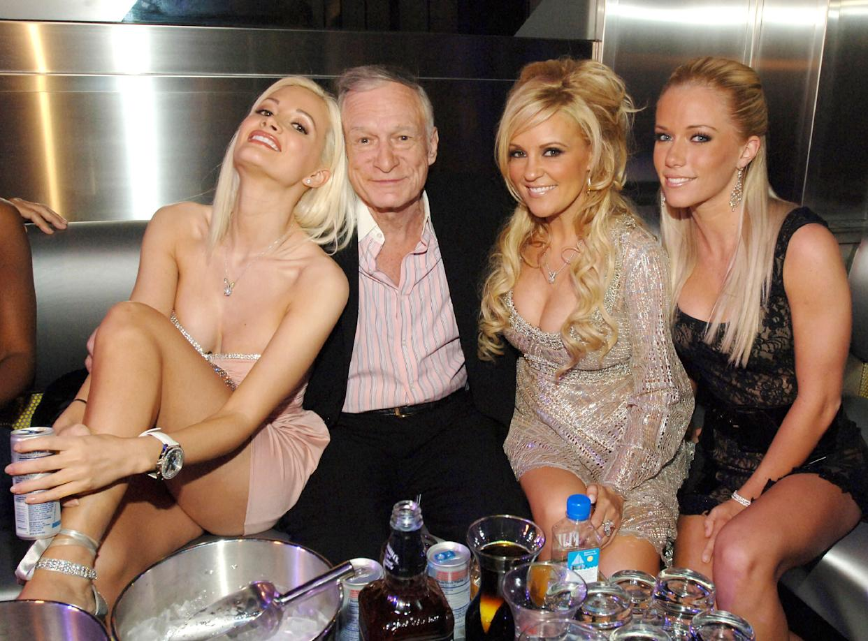 """Holly Madison, Hugh Hefner, Bridget Marquardt and Kendra Wilkinson. The reality series """"The Girls Next Door"""" followed Hefner's relationships with the three women. (Photo: Denise Truscello via Getty Images)"""